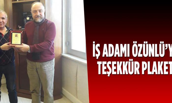 İŞ ADAMI ÖZÜNLÜ'YE TEŞEKKÜR PLAKETİ